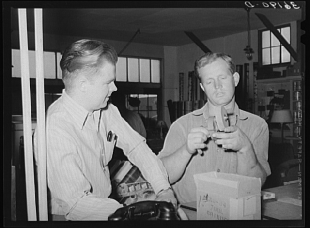Member of the United Producers and Consumers Cooperative buying a small tool grinder. Phoenix, Arizona