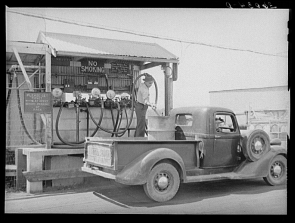 Member of the United Producers and Consumers Cooperative having a drum filled with gasoline at the warehouse. Phoenix, Arizona