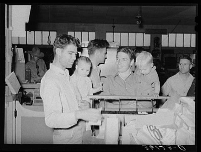 Members and their children at the wrapping desk of the United Producers and Consumers Cooperative. Phoenix, Arizona
