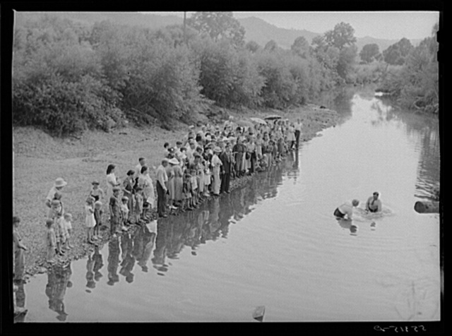 Members of the Primitive Baptist Church in Morehead, Kentucky, attending a creek baptizing by submersion
