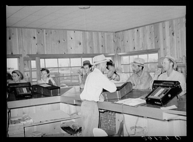 Members of the United Producers and Consumers Cooperative waiting to be served at the lumberyard office. Phoenix, Arizona