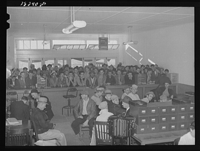 Men applying for work at the office of the Texas State Employment Service, Corpus Christi, Texas. In Corpus Christi there is now surplus supply of unskilled labor and a shortage of skilled labor