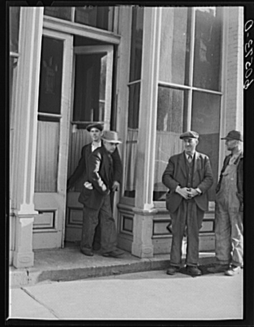 Men coming out of the city mission after evening meal. Dubuque, Iowa