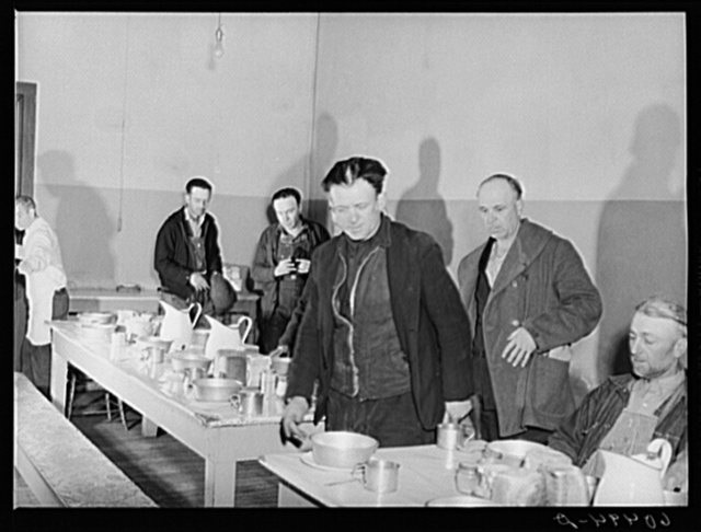 Men filing into dining hall at 5:00 p.m. for evening meal at Dubuque, Iowa, at city mission. Community chest-financed. Dubuque, Iowa
