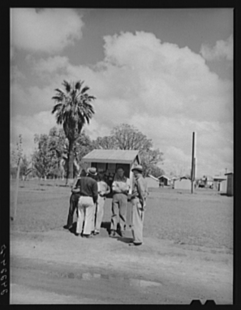 Men in front bulletin board. Tulare migrant camp. Visalia, California