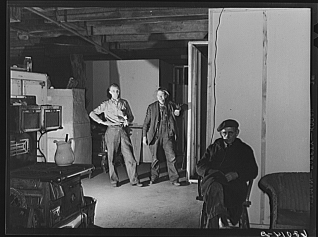 Men in the basement of Mr. Tilly's secondhand furniture store. He is fixing up living quarters for fifty. Radford, Virginia