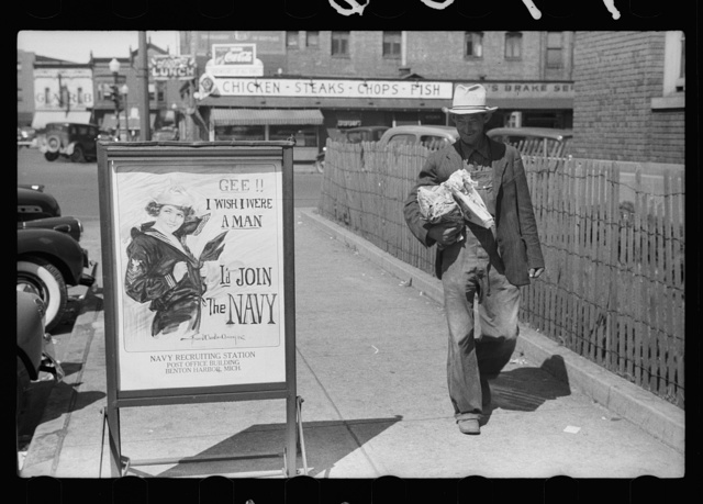 Migrant fruit worker from Arkansas walking by the post office, Benton Harbor, Michigan