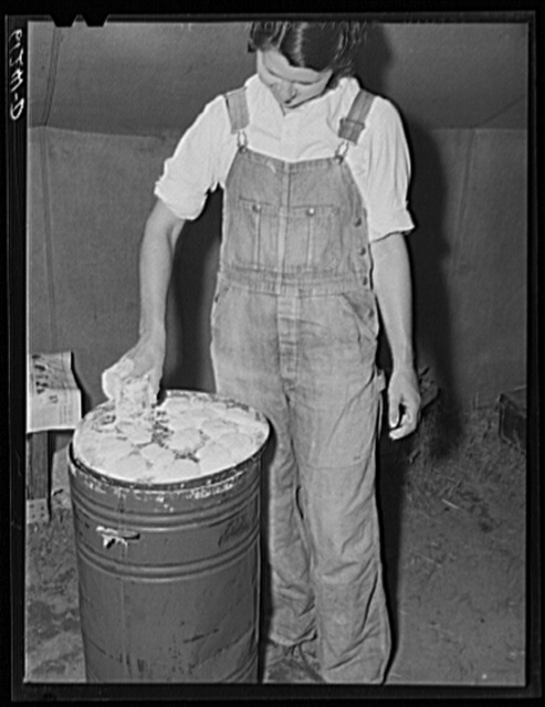 Migrant fruit worker making biscuits in her tent home. Berrien County, Michigan