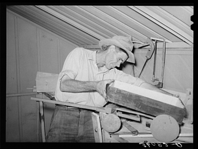 Migratory agricultural laborer making toys for the WPA (Work Projects Administration) nursery school at the Agua Fria migratory labor camp. Arizona