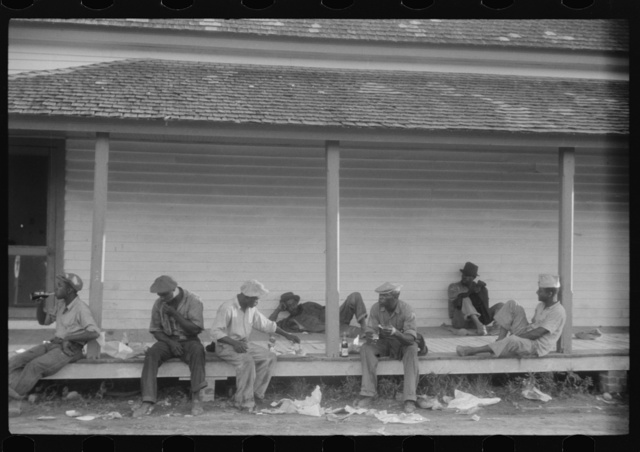 Migratory agricultural workers having supper at the store in Belcross, North Carolina