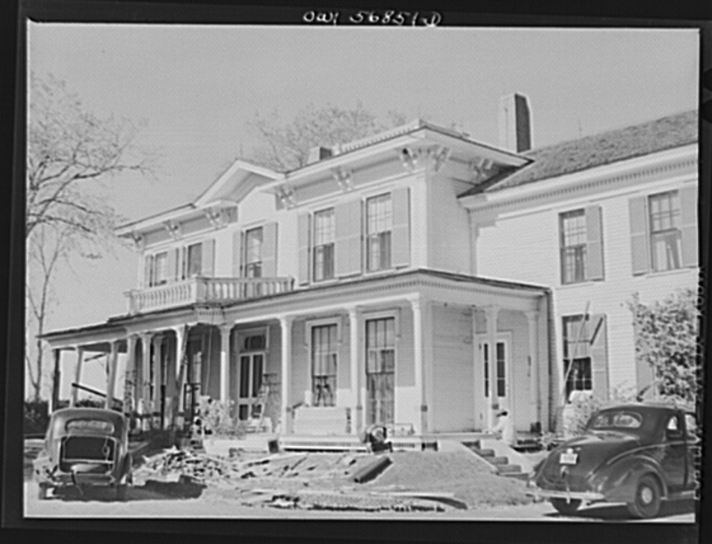 """Miscellaneous lot of photographs by Barbara Wright, e.g. University of Virginia, Franconia, New Hampshire, Maine. Repairs being made to the Washburne homestead """"The Norlands,"""" Livermore, Maine"""