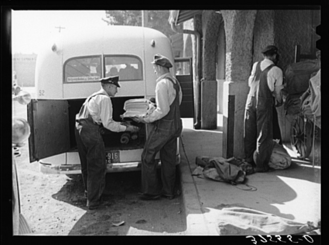 Montrose, Colorado, is junction point for standard gauge and narrow gauge railroads and bus lines. Papers and mail are being loaded into bus for transporting to towns along the route