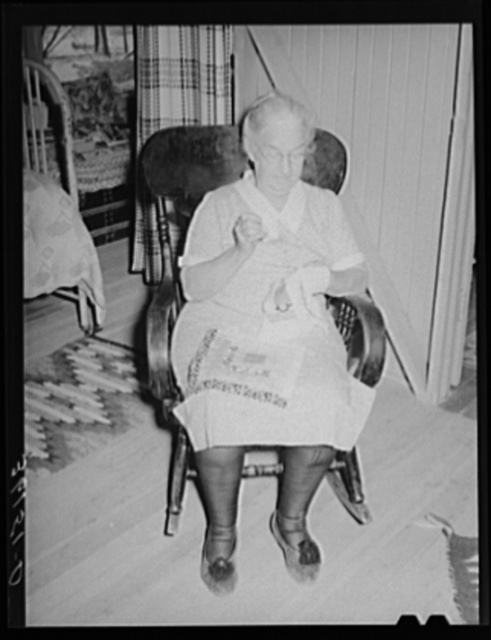 Mother of tenant purchase client piecing a quilt. Maricopa County, Arizona