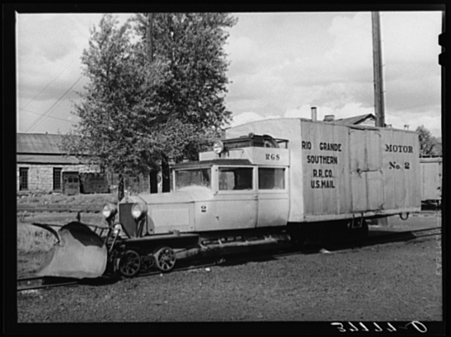 Motor locomotive of railroad equiped with snow plow. Durango, Colorado