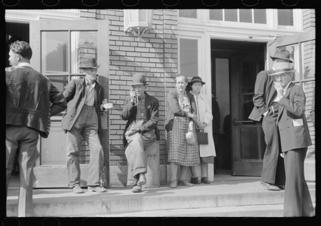 Mountain people exchanging greetings and news on court day in front of the federal building, Jackson, Breathitt County, Kentucky