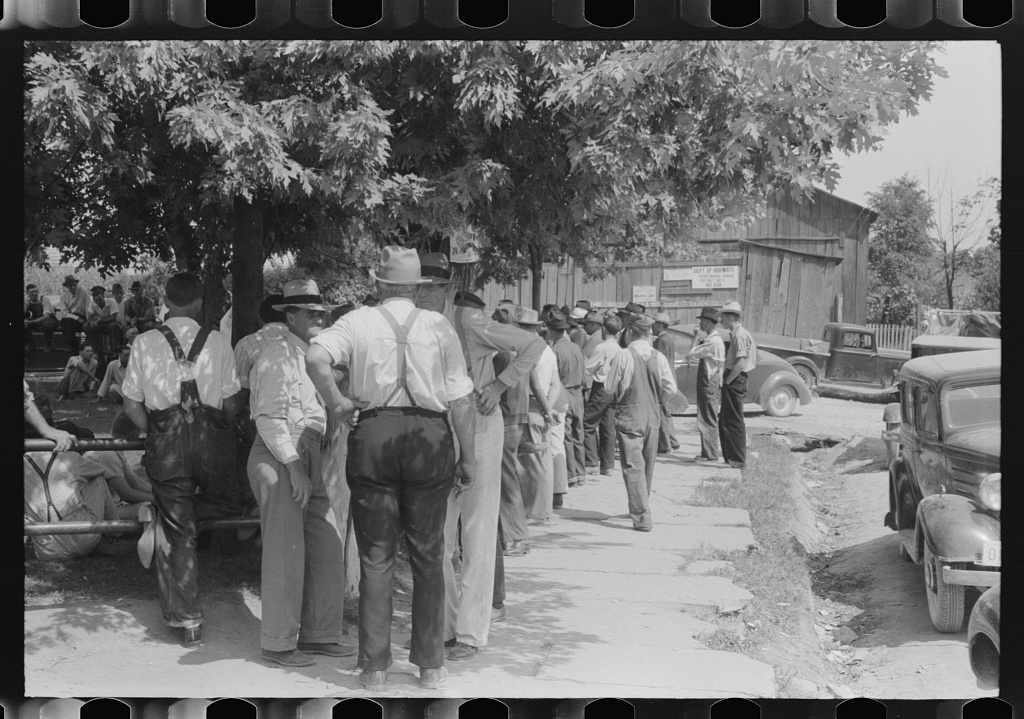 Mountaineers and farmers exchange news near courthouse on court day. Campton, Wolfe County, Kentucky
