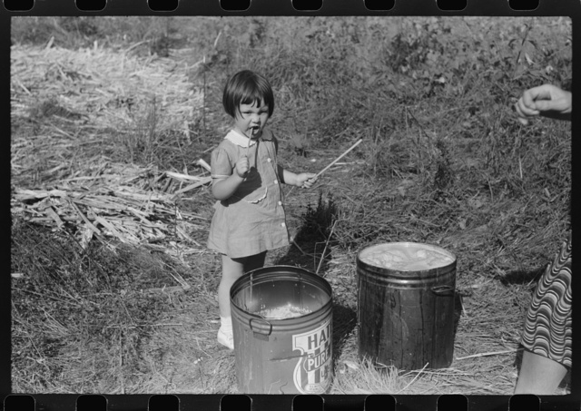 "Mountaineer's daughter enjoying the sorghum syrup at a neighbor's home during a ""syrupping off,"" Breathitt County, Kentucky"