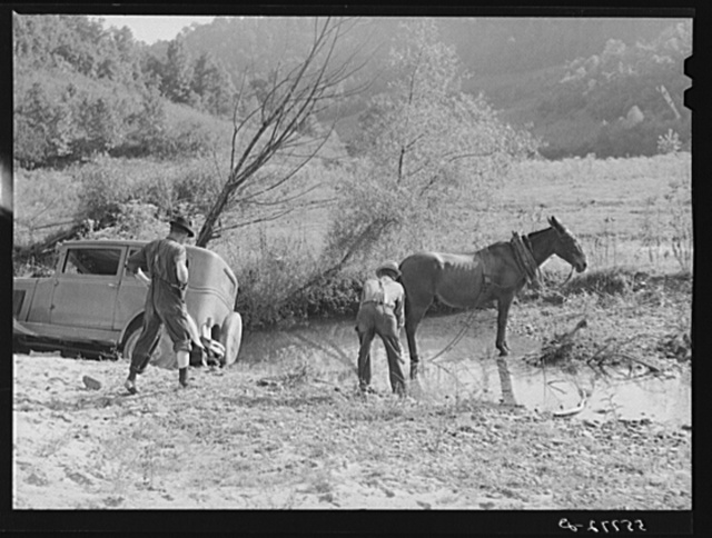 Mountaineers trying to pull the car out of the creek with a mule. South Fork of the Kentucky River. Breathitt County