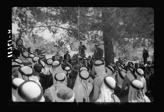 Mr. E. Keith Roach & Mrs. K.R. entertain Sir Harold & Lady MacMichael & 500 falahen at Neby Saleh. The crowd listening to mukhtars making patriotic speeches address to H.E. (i.e., His Excellency)