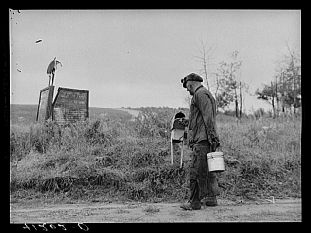 Mr. Ralph Reitz, miner and farmer, member of Tri-County Farmers Co-op Market at Du Bois, Pennsylvania, stops at mail-box on way home from mine, at his farm near Falls Creek, Pennsylvania