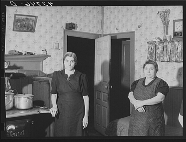 Mrs. D'Achioli and her sister. They run a truck farm and are FSA (Farm Security Administration) clients. There are fourteen in the family, some of whom help out by working in the mills. Johnston, Rhode Island
