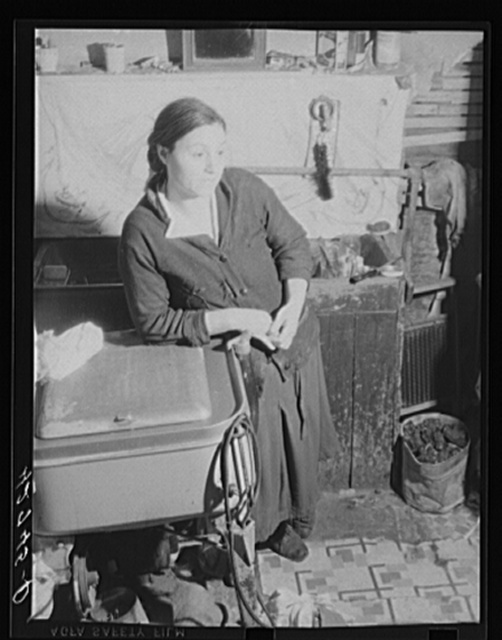 Mrs. M. Vieta, Portuguese wife of a FSA (Farm Security Administration) client. At present she is looking after the farm and the children while her husband works at the torpedo station in Newport. Portsmouth, Rhode Island
