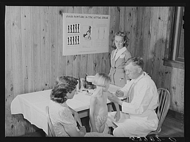 Mrs. M.E. Chappell with her daughter, Sybil Lee, being given typhoid anti-toxin by Dr. F.A. Williams, director of East Carroll Parish health unit, assisted by Miss Lucy Akin, community nurse, in the project school clinic. Transylvania Project, Louisiana