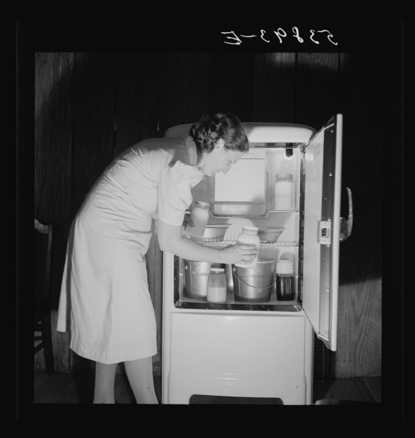 Mrs. Pleas Rodden putting fresh milk from their own cow in their frigidaire. They are FSA (Farm Security Administration) rural rehabilitation borrowers. West Carroll Parish, Louisiana