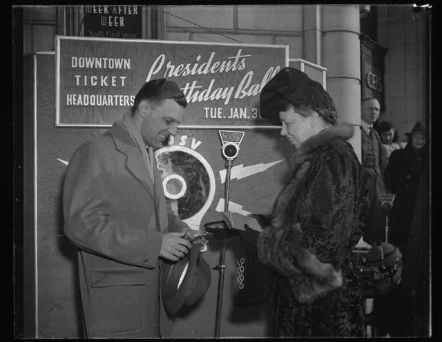 MRS. ROOSEVELT BUYS FIRST TICKET TO PRESIDENT'S BIRTHDAY BALL. WASHINGTON, D.C. JANUARY 16. LAUNCHING A DRIVE FOR THE SALE OF TICKETS TO THE PRESIDENT'S BIRTHDAY BALL SCHEDULED FOR JAN. 30, MRS. ROOSEVELT TODAY BOUGHT TICKET NO. 1 FROM WJSV ANNOUNCER A.D.-JESS- WILLARD AND MADE A SHORT BROADCAST APPEALING FOR SUPPORT OF THE FUNCTION, FUNDS FROM WHICH WILL GO TO RELIEVE SUFFERING FROM INFANTILE PARALYSIS. WILLARD IS GENERAL MANAGER OF RADIO STATION WJSV, CENTRAL TICKET AGENCY FOR THE SALE OF TICKETS