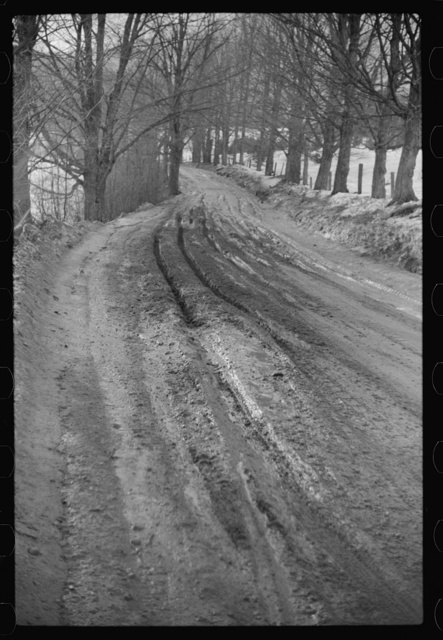 Muddy road after thaw, near Stowe, Vermont