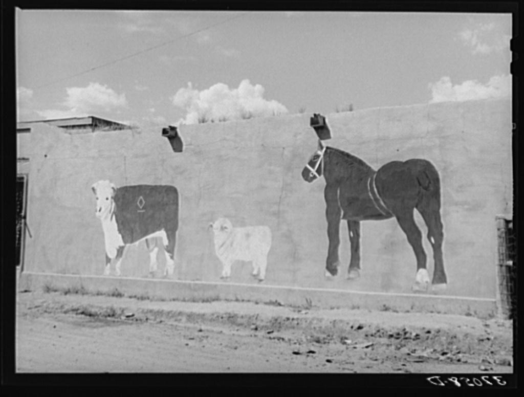 Native art on adobe wall. Amalia, New Mexico