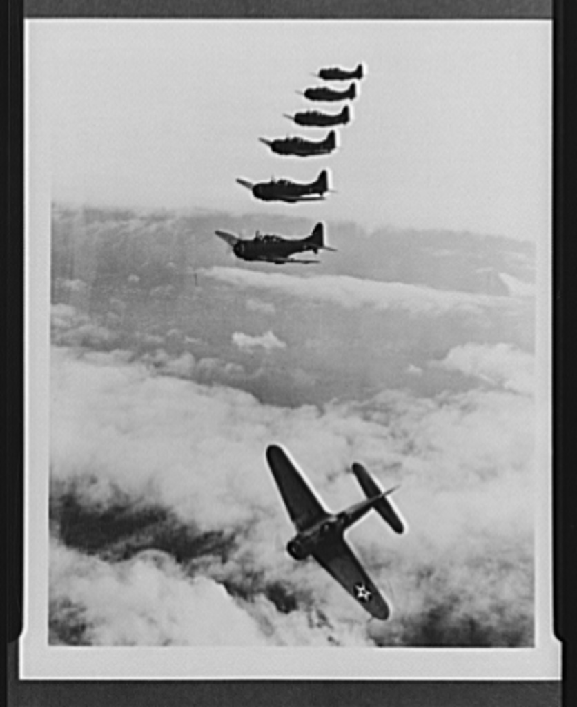 Navy aircraft. Douglas dauntless dive bomber. Dive bomber peeling off for attack