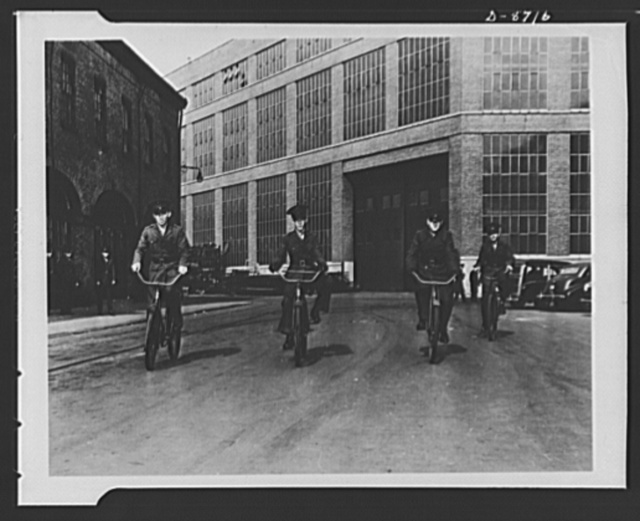 Navy yard, Brooklyn, New York. Marine messengers on their daily tour of the yard with important orders for various commanders