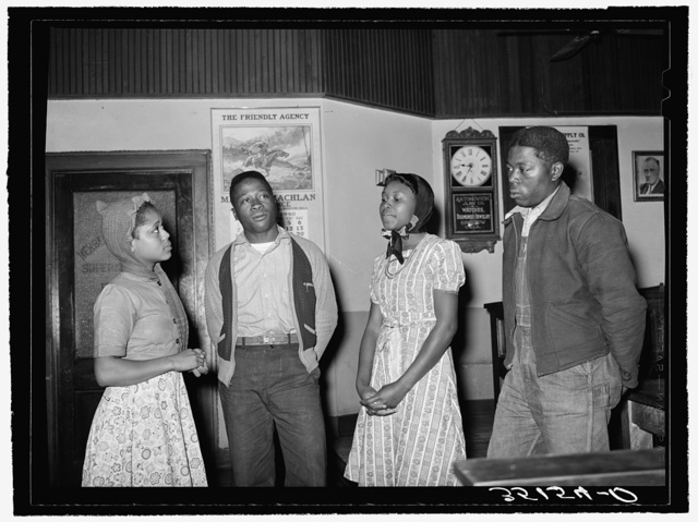 Negro boys and girls humming spiritual at UCPAPWA (United Cannery, Agricultural, Packing, and Allied Workers of America) meeting, Bristow, Oklahoma. The union meeting has become a main social gathering in these sections and has taken on some of the spirit of the old time revival. Spirituals vie with the union songs for popularity