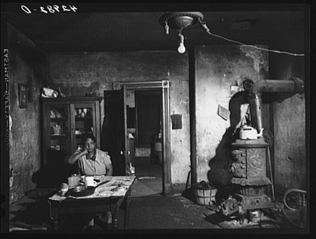 Negro woman in a dilapidated house in the Mount Washington district of Beaver Falls, Pennsylvania