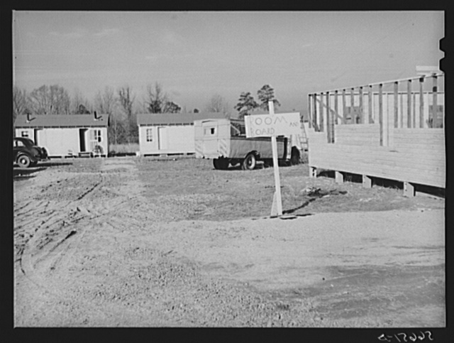 New buildings for use of construction workers on Camp Clairborne job.  Eight dollars and fifty cents for lodging and board (several people in one room). Property in this section now priced at two hundred dollars per acre. Gas station attendant says different people own every fifty feet. Alexandria, Louisiana