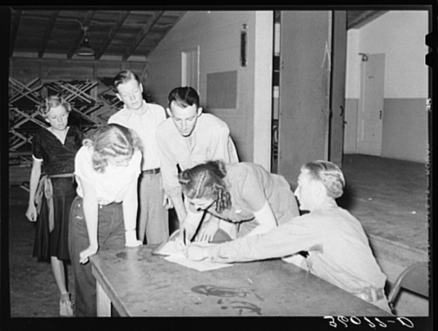 New members signing up at the young people's club at the Agua Fria migratory labor camp. Arizona