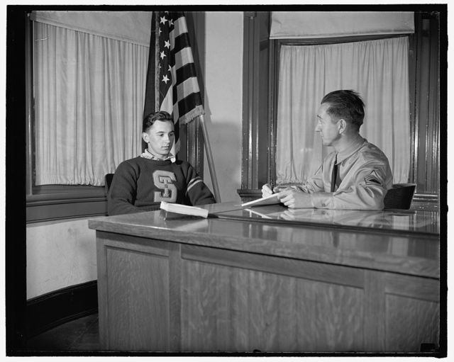 New recruits join up, Washington, D.C. Louis Benne, 19 years old, of Friedens, PA., being interviewed by Sergeant Norman W. Morgan, at desk