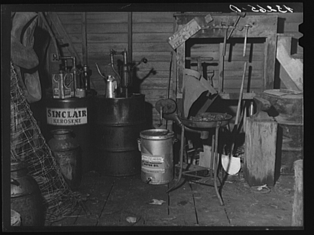 Oil cans and soldering equipment in barn on farm near Rockville, Maryland