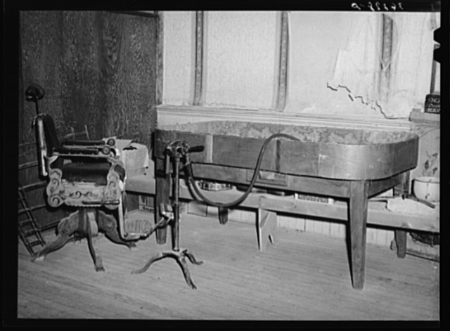 Old dice table and barber chair on display at the Bird Cage Theater museum. Tombstone, Arizona