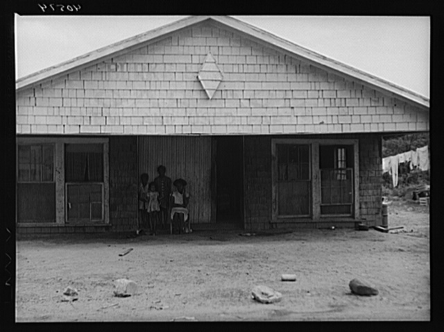 Old garage used for a dwelling by a Negro family. Outskirts of Graham, North Carolina