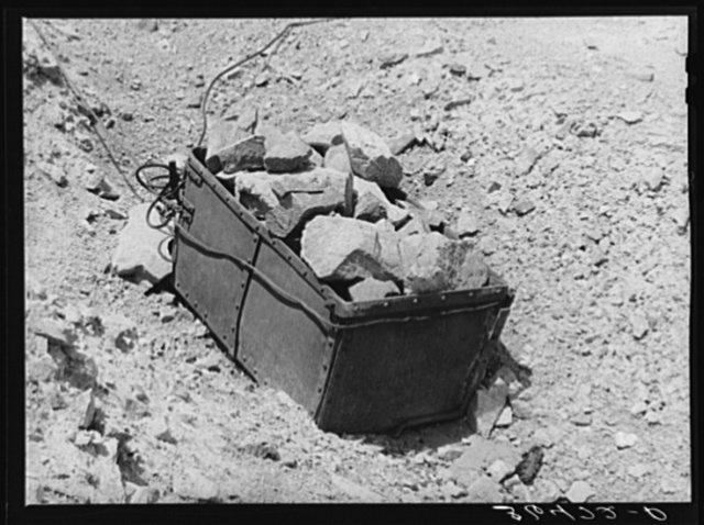 Old ore bucket and gold ore at abandoned gold mine at Pinos Altos, New Mexico