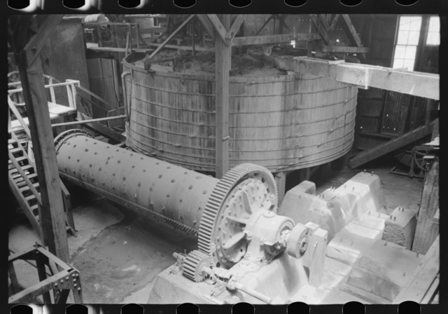 Old tube mill in foreground with agitating tank in background. Gold mine at Mogollon, New Mexico