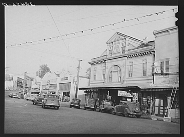 On the main street of Auburn, county seat of Placer County, California. This was first a mining section when gold was discovered in California and later became a fruit section. It is now on the decline