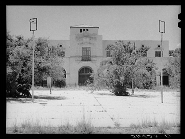 One of the main buildings with town square in foreground of the Burro Mountain Copper Company, now inactive, at Tyrone, New Mexico