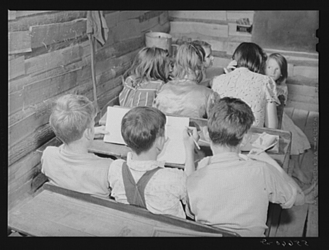 One-room schoolhouse showing overcrowded conditions and need for repairs and equipment. Breathitt County, Kentucky