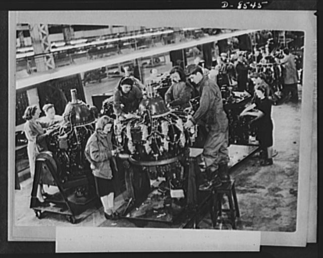 One year of reciprocal aid. British girls and American technicians work together at a U.S. Army Air Force maintenance department. This is only one of dozens of services rendered our forces by British civilians. The British government pays $240,000 a week in wages to civilian workers in the direct employ of the U.S. forces