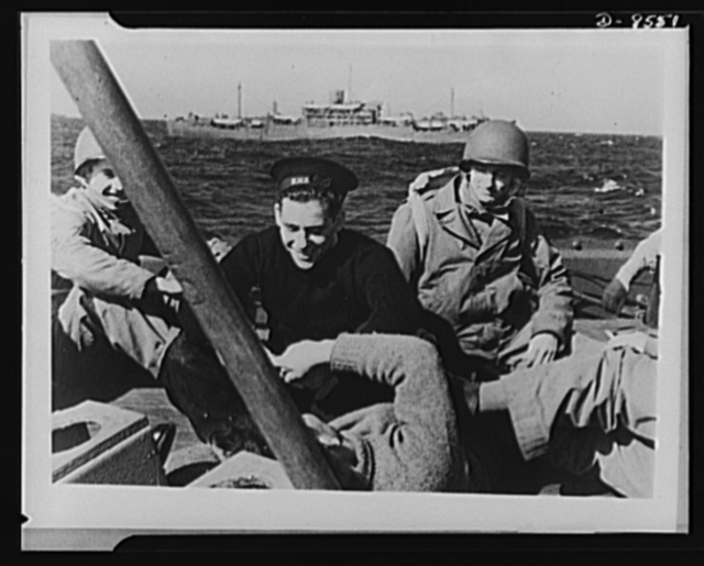 One year of reciprocal aid. British sailors and U.S. Rangers share a joke as well as ships. More than thirty troops, transports of the British Merchant Navy, were in the first convoy that swept through the Mediterranean in the invasion of North Africa, in company with American forces under escort of the Royal Navy. American aviators flew British Spitfire planes, in a joint action that established the Allied second front. The principle of sharing by the Allies paid tremendous dividends in this action
