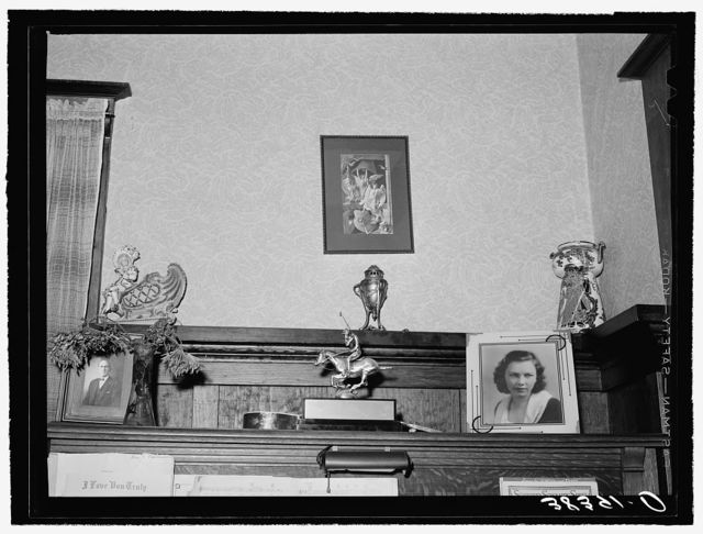 Ornaments on top of piano in living room of fruit farmer. Placer County, California. These farmers have had a very high living standard. Center figure is award this farmer's daughter helped win in polo match