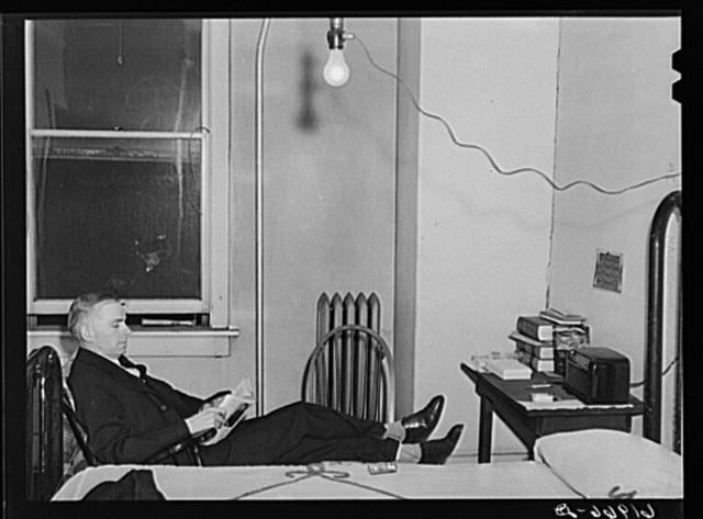 Out of state employee of Hercules powder plant in his room at Mrs. Sells boardinghouse. Radford, Virginia